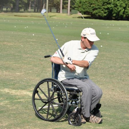 man golfing from a wheelchair