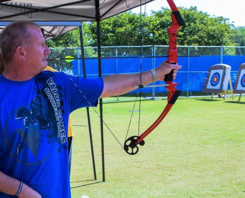Valor Games Southeast Athlete using mouth tab to pull back bow