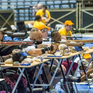 group picture of several people with disabilities shooting air rifle