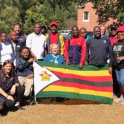 Group picture with Zimbabwe guests withflag