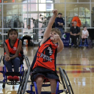 Bridge 2 Sports Youth wheelchair basketball player shooting a foul shot