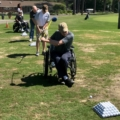 several people with different disabilites golfing