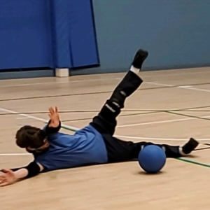 goalball athlete outstretched blocking ball