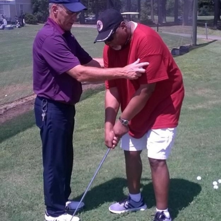 golf coach teaching golf to athlete with visual impairmentwi