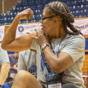 Female Veteran flexing bicep at Valor Games Southeast 2019