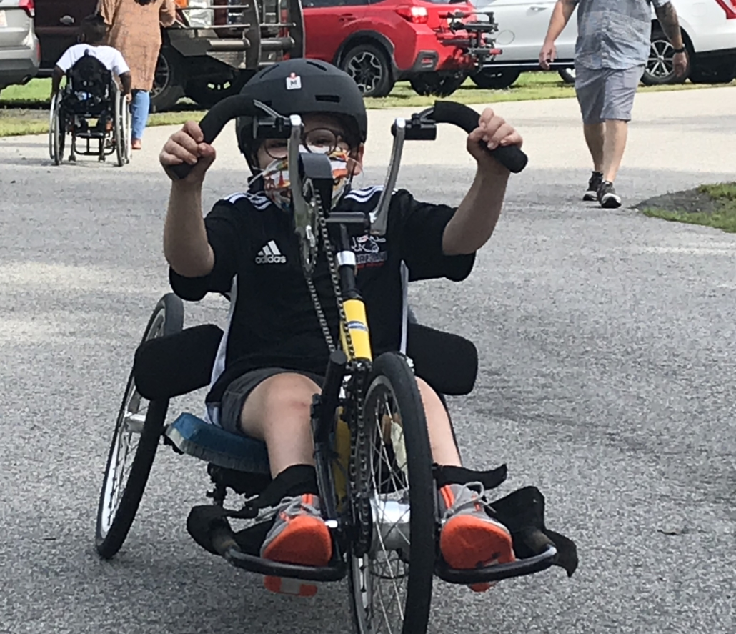 young boy in handcycle