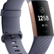 gray and rose gold Fitbit