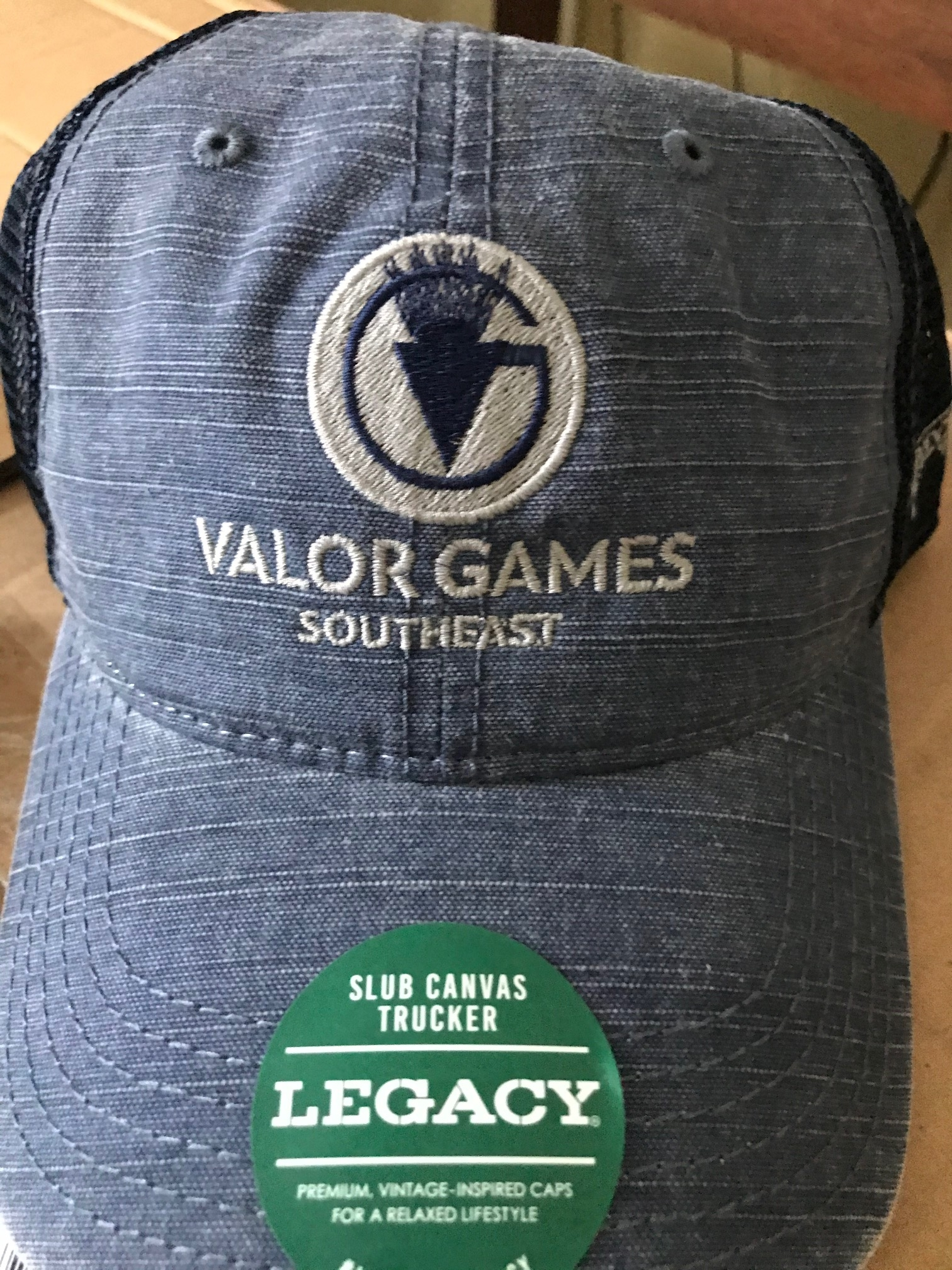 blue baseball style cap with silver stiching of Valor Games Southeast text and logo