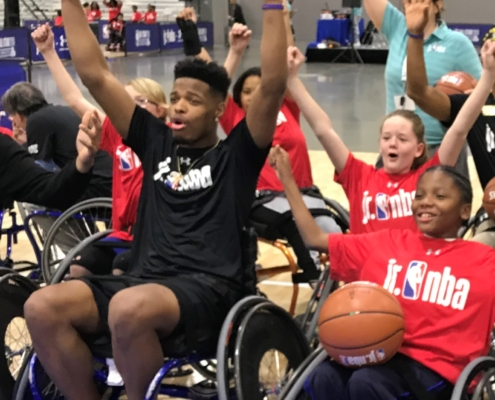 NBA player Dennis Smith Jr. playing wheelchair basketball with B2S Team PRIDE players at Jr NBA day 2019