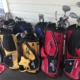 Eight golf bags with clubs on Bridge 2 Sports porch