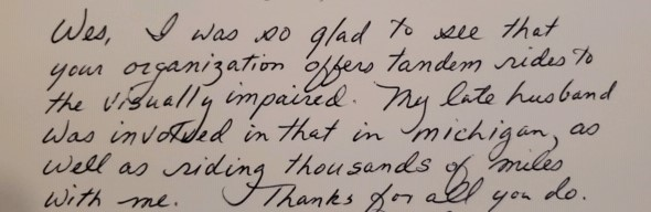 """handwritten note reads """"Wes, I was so glad to see that your organization offers tandem rides to the visually impaired. My late husband was involved in that in Michigan, as well as riding thousands of miles with me. Thanks for all you do."""""""